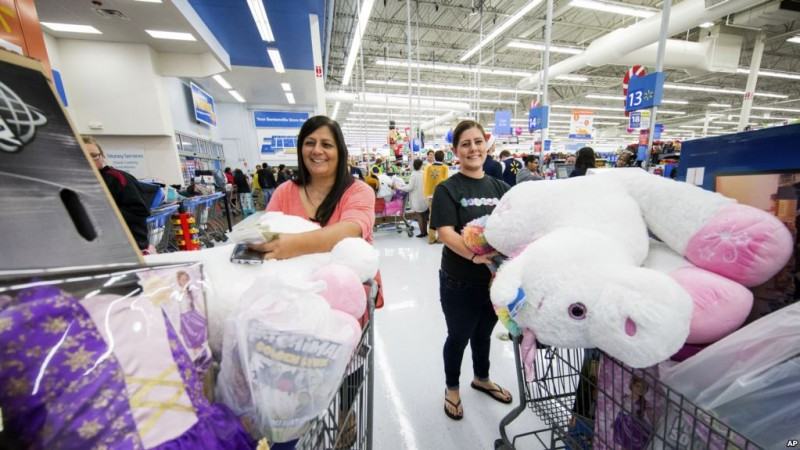 IMAGE DISTRIBUTED FOR WALMART - Customers secure Black Friday deals at a Walmart on Thursday, Nov. 23, 2017 in Bentonville, Ark. This year, Walmart offered hundreds of Black Friday deals in stores and online across categories including TVs, electronics, toys, and gaming consoles. (Gunnar Rathbun/AP Images for Walmart)