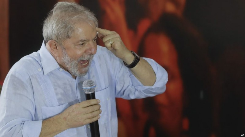 Former Brazilian President Luiz Inacio Lula da Silva speaks during a meeting with the executive members of the Workers Party, in Sao Paulo, Brazil, Thursday, Jan. 25, 2018. Former President Lula said he will run for Brazil's Presidency again, even after an appeals court unanimously upheld a graft conviction against him and added years to his prison sentence.(AP Photo/Andre Penner)