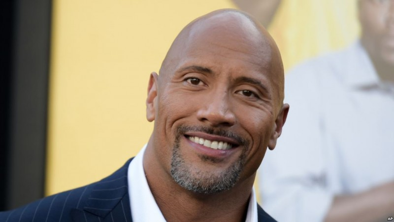 """Dwayne Johnson attends the LA Premiere of """"Central Intelligence"""" held at the Regency Village Theater on Friday, June 10, 2016, in Los Angeles. (Photo by Richard Shotwell/Invision/AP)"""