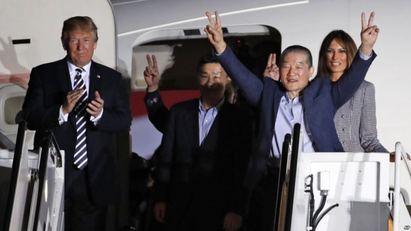 President Donald Trump and first lady Melania Trump greet former North Korean detainees Kim Dong Chul, Tony Kim and Kim Hak Song upon their arrival, Thursday, May 10, 2018, at Andrews Air Force Base, Md. (AP Photo/Alex Brandon)