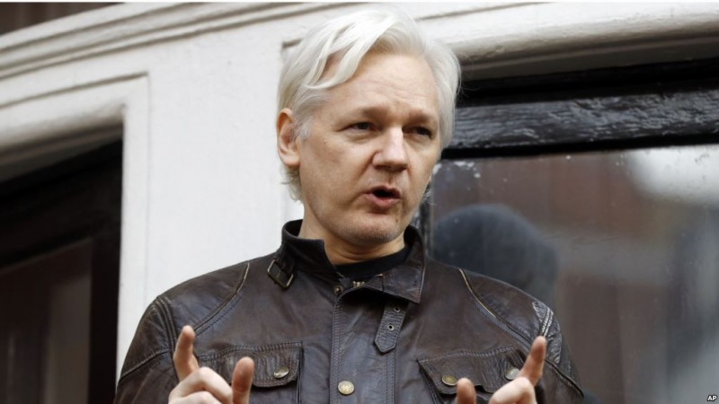 Julian Assange speaks to the media outside the Ecuadorian embassy in London, Friday May 19, 2017. Sweden's top prosecutor says she is dropping an investigation into a rape claim against WikiLeaks founder Julian Assange after almost seven years. Assange took refuge in Ecuador's embassy in London in 2012 to escape extradition to Sweden to answer questions about sex-crime allegations from two women. (AP Photo/Frank Augstein)