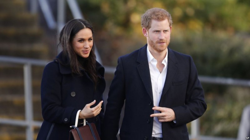 Britain's Prince Harry and his fiancee Meghan Markle arrive at Nottingham Academy in Nottingham, England , Friday, Dec. 1, 2017. It was announced on Monday that Prince Harry and American actress Meghan Markle are engaged and will marry in the spring of 2018. (AP Photo/Frank Augstein)