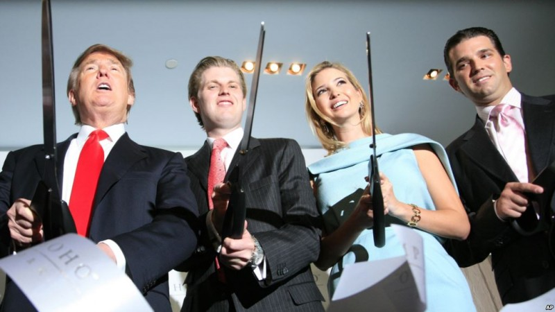Donald Trump, left, chairman and CEO of the Trump Organization, cuts the ribbon with his children Eric, Ivanka, and Donald Trump, Jr. right, at the opening of the Trump SoHo New York, Friday, April 9, 2010. The 46 story hotel condominium has 391 units. (AP Photo/Mark Lennihan)