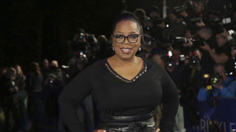 Actress Oprah Winfrey poses for photographers upon arrival at the premiere of the film 'A Wrinkle In Time' in London, Tuesday, March 13, 2018. (Photo by Joel C Ryan/Invision/AP)