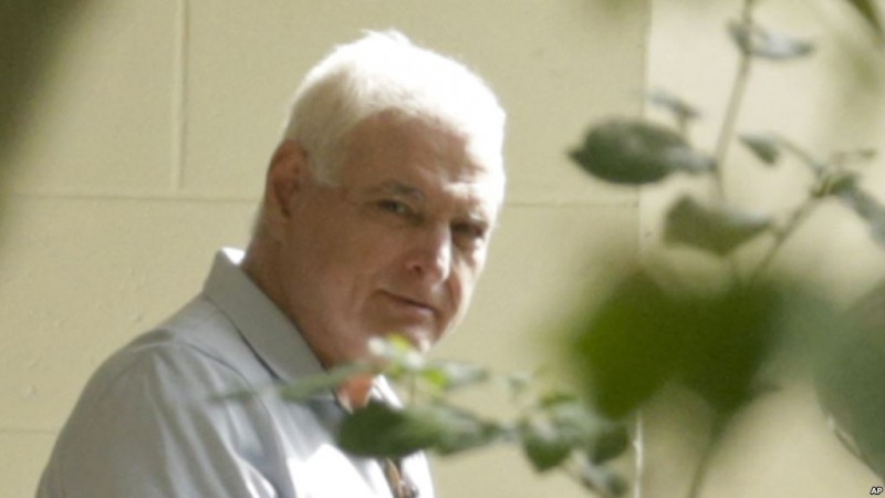 Former Panamanian President Ricardo Martinelli handcuffed walk out from a cell in El Renacer jail on Gamboa, Panam. Monday, June 11, 2018. Martinelli returned to Panama to face political espionage and embezzlement charges after being extradited from the United States on Monday (AP Photo/Arnulfo Franco)